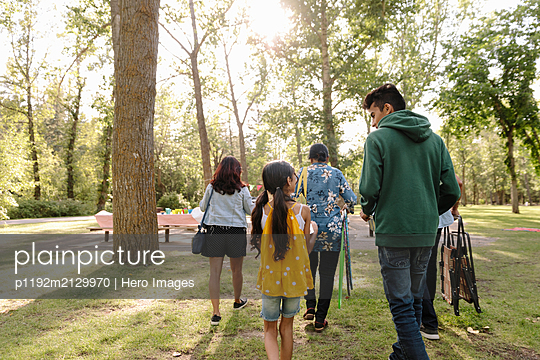 Family spending day together in urban park - p1192m2129970 by Hero Images