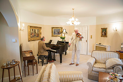 Two senior men playing music together - p1026m1164192 by Patrick Frost