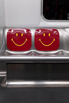 Smiley underground train seats in Hong Kong - p795m2223229 by JanJasperKlein