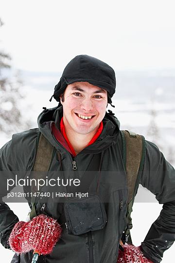 Smiling man at winter