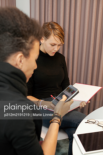 Colleagues at work meeting - p312m2191219 by Marie Linnér