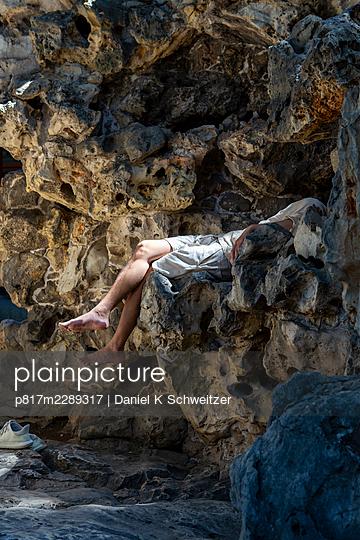 Mann lying among rocks, Beihai Park, Peking - p817m2289317 by Daniel K Schweitzer