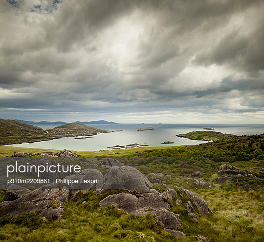 Dramatic sky over Kenmare Bay, Ireland - p910m2209861 by Philippe Lesprit