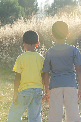 Two boys standing outdoors  - p794m1131590 by Mohamad Itani