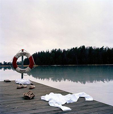 Clothes on a jetty in the archipelago Sweden - p5280248f by Anthony Hill