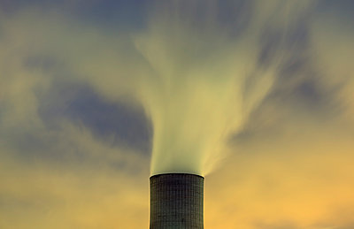 Top of cooling tower and blurred smoke at night - p429m958597f by Mischa Keijser