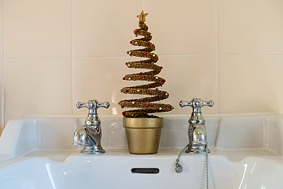 Christmas Decorations in the Bathroom - p1309m1200004 by Robert Lambert