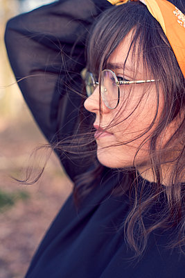 Profile of a young woman with glasses - p1621m2295387 by Anke Doerschlen