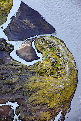 Aerial view of green coastline and frozen water, Landmannalaugar,  Iceland - p1026m992061f by Romulic-Stojcic