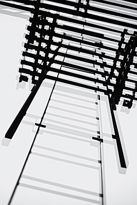 Looking up fire escape ladder - p301m960778f by Michael Mann