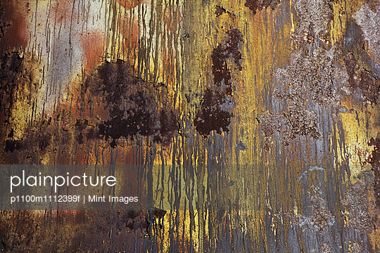 A wall with paint drips and marks and rust stains on metal. - p1100m1112399f by Mint Images