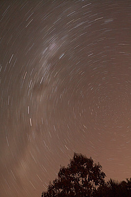 Light trails of stars in the night sky, long-term exposure - p1612m2223525 by Heidi Coppock-Beard