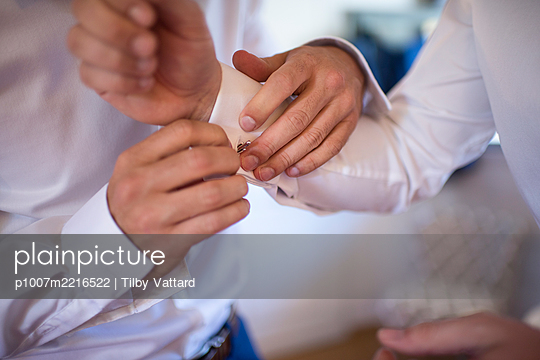 Fixing the cuff links - p1007m2216522 by Tilby Vattard
