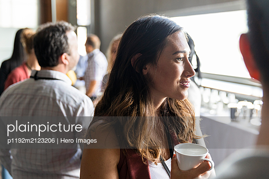 Businesswoman networking during conference coffee break - p1192m2123206 by Hero Images