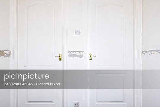 Two doors in a house being redecorated  - p1302m2245048 by Richard Nixon