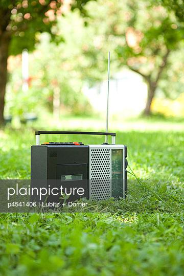 Portable radio in a park - p4541406 by Lubitz + Dorner