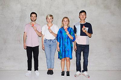 Four friends with melon - p276m2115586 by plainpicture