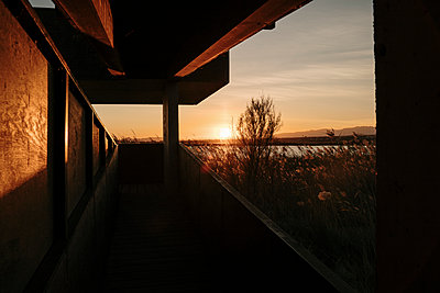 Spain, Ebro Delta, Sunset over landscape with architecture element - p300m2250181 by VITTA GALLERY