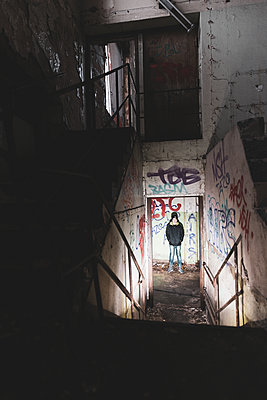 Teenage boy inside abandoned building - p312m2092136 by Mikael Svensson