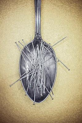 Needles on spoon - p971m1222611 by Reilika Landen