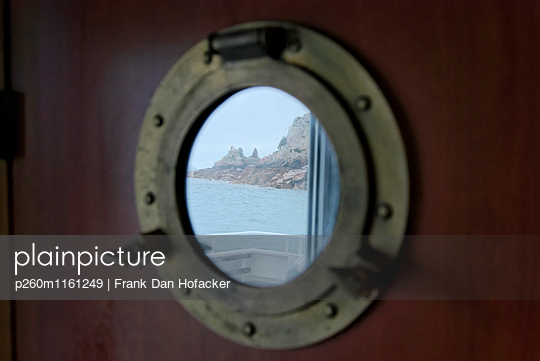 Looking through a port light - p260m1161249 by Frank Dan Hofacker