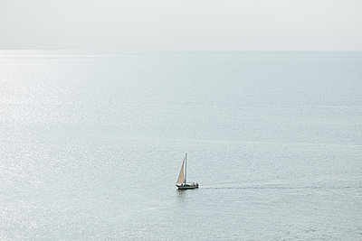 Small sailing boat on the Baltic Sea - p1507m2205022 by Emma Grann