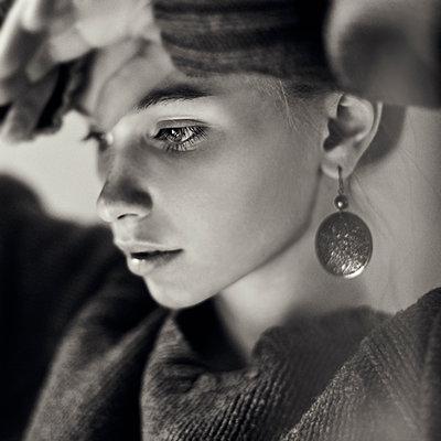 Close up of pensive Caucasian girl - p555m1412882 by Vladimir Serov