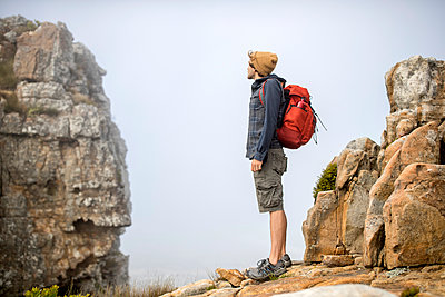 Young man on a hiking trip high in the mountains - p1355m1574144 by Tomasrodriguez