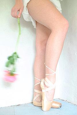 Ballerina holding rose - p1521m2064516 by Charlotte Zobel