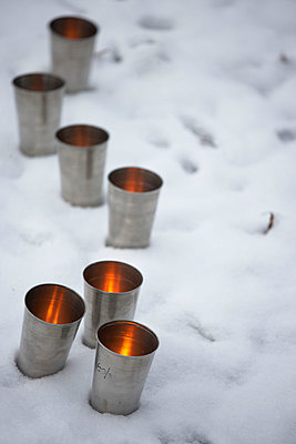 Metallic tealights in snow - p3493772 by Jan Baldwin