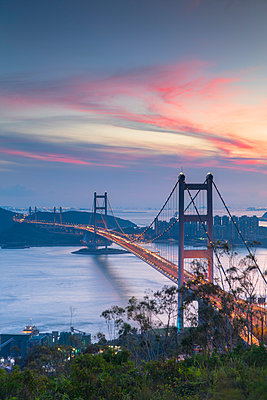 Tsing Ma Bridge at sunset, Tsing Yi, Hong Kong, China - p651m2033231 by Ian Trower
