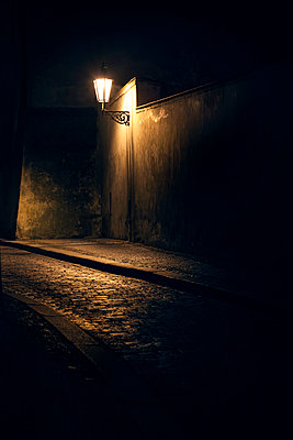 Cobbled road at night - p1280m1516388 by Dave Wall