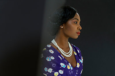 Afrixan woman wearing charming dress - p427m2004889 by Ralf Mohr