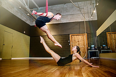 Caucasian acrobats training on ropes in studio - p555m1412618 by Inti St Clair