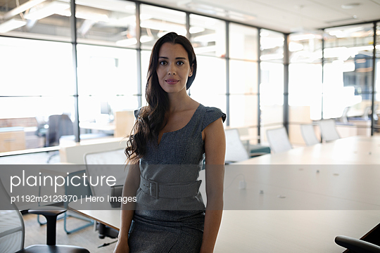 Portrait of businesswoman looking at camera - p1192m2123370 by Hero Images