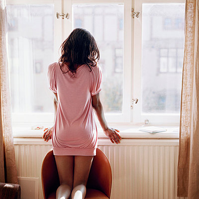 Teen girl looking out window - p312m672825 by Johanna Nyholm