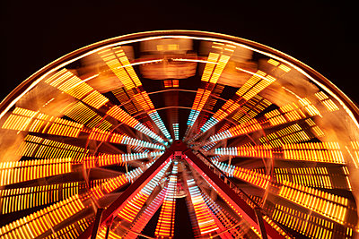 Fairground ride at night, long exposure - p924m1197653 by Matt Hoover Photo