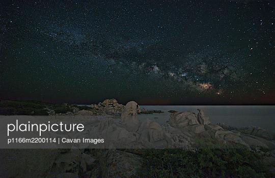 Night landscape at Punta Molentis Sardinia. The Milky Way over the sea - p1166m2200114 by Cavan Images