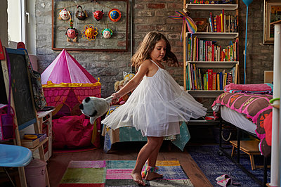 Girl dancing in their room - p1640m2245859 by Holly & John