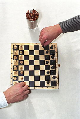 Two Men's Hands and a Chess Board - Two Men playing Chess (Detail) - p4737185f by Stock4B