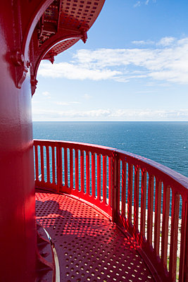 On top of a red lighthouse in Norway - p1682m2270262 by Régine Heintz