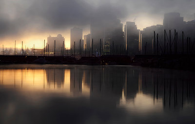 Early morning fog and mist over the waterfront and tall buildings of Vancouver - p555m1453739 by Spaces Images