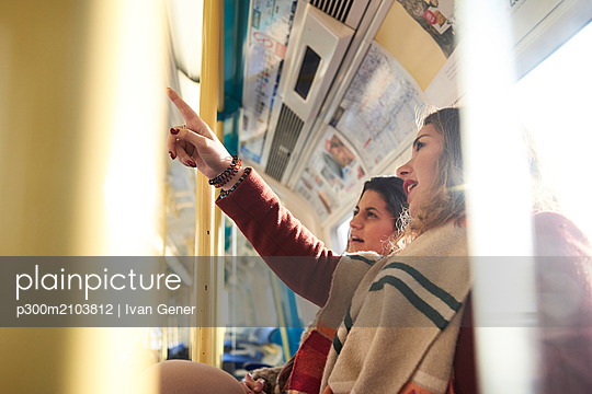 UK, London, two women in underground train checking the connection - p300m2103812 by Ivan Gener