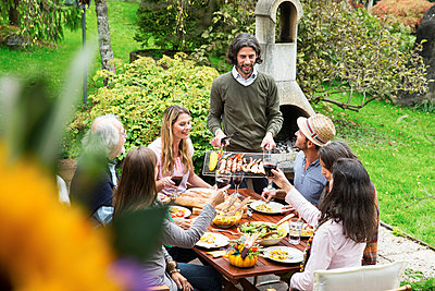 People on a barbecue - p300m929772f by Adrian Raba