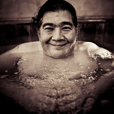 Smiling Man in Hot Tub - p6942116 by Michael Donnor
