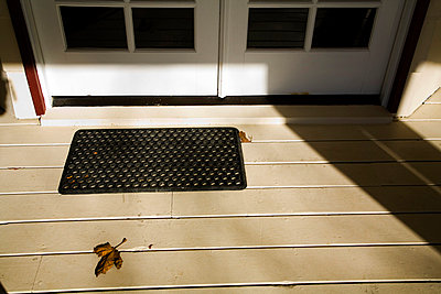 Leaf on Porch by Doormat - p5551140f by LOOK Photography