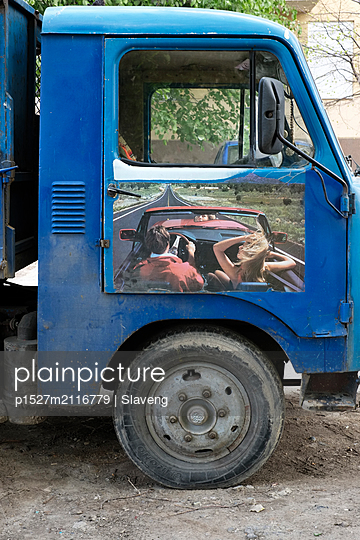 Old truck with a poster  - p1527m2116779 by Slaveng