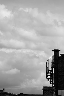 Low angle view of stairwell on building against cloudy sky - p301m1406537 by Michael Mann