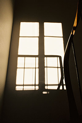Staircase with window in the sunlight - p873m2196011 by Philip Provily