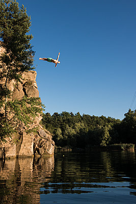 Cliff diving - p1142m1220746 by Runar Lind